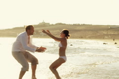 Couple in love on the sunny beach, slow motion, shot at 60fps - stock footage