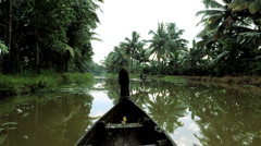 Local canoes passing Kerala backwaters, nr Alleppey India - stock footage