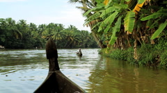 Local canoes passing on the Kerala backwaters, nr Alleppey India - stock footage