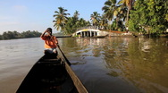 Traditional canoeing on the backwaters Kerala, nr Alleppey, India Stock Footage
