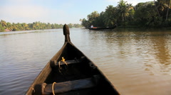 Water traffic on the Kerala backwaters nr Alleppey, India - stock footage