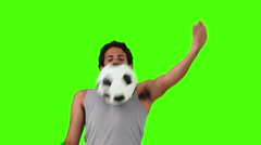 Man in sportswear playing with a soccer ball - stock footage