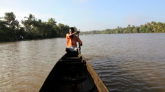 Traditional canoeing by local people on the backwaters, Kerala, India - stock footage