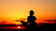 Silhouette of woman meditating during sunset Stock Footage