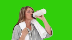 Senior woman after sport drinking water Stock Footage