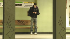 Teenager waiting for the underground train  Stock Footage