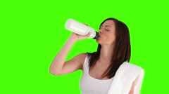 Brunette woman after sport drinking water Stock Footage