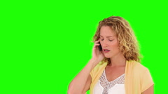 Curly blond haired having a phone call Stock Footage
