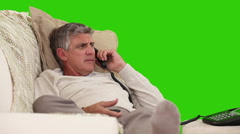 Casual retired man talking on the phone Stock Footage