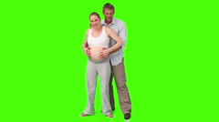 Stock Video Footage of Man stroking the belly if his pregnant woman