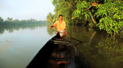 Traditional canoeing by local people on the backwaters, Kerala, India Stock Footage