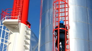 Stock Video Footage of Worker climbs up on the silo