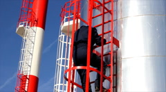 Worker goes down from the Silo - stock footage