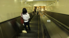 Woman Riding Down Escalator - stock footage