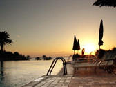 Sunbeds by the infinity pool at the sunrise Stock Footage