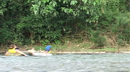 Inner tubing on the Nam Xong river Stock Footage