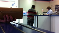 Man applying for passport at USPS Stock Footage