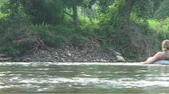 Inner tubing on the Nam Xong river - stock footage