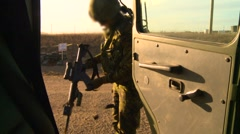 Military, soldier clearing weapon and getting into truck Stock Footage