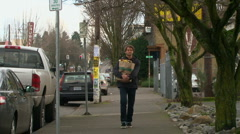Young man with walking with groceries Portland Oregon Stock Footage