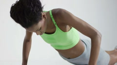 Young woman doing push-ups Stock Footage