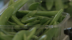 Green beans close while transported Stock Footage