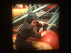 Cute Little boy riding Sky fighter carnival ride Stock Footage