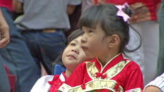 Two Asian Girls At Chinese New Years Party Stock Footage