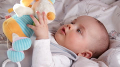 Baby and toy 2 - stock footage