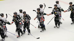 Players shaking hands after an ice hockey game Stock Footage