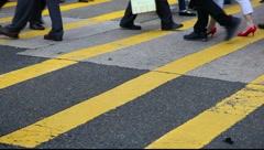 People crossing city street Stock Footage