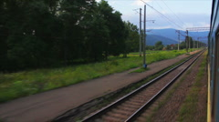Passenger train goes to Carpathians (view from the train window) - stock footage