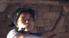 Khmu woman with pipe Stock Footage