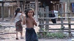 Khmu girl waves Stock Footage