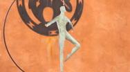 Foil Metal figure twirling in front of adobe wall. Stock Footage