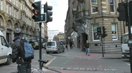 Stock Video Footage of Very busy city street corner with elegant historic stone buildings