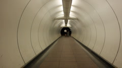 Couple Walking Down Tunnel - stock footage