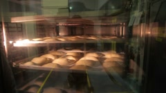 Pastries in an oven in a commercial bakery Stock Footage
