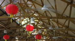 3 Ceiling Fans With Red Chinese Hanging Lanterns  Stock Footage