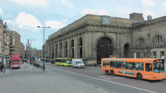 Busy street scene with buses outside Newcastle Central Station Stock Footage