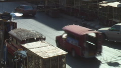 Thailand: Market vendor pushes cart amid traffic Stock Footage