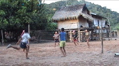 Khmu boys playing soccer with wicker ball Stock Footage