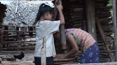 Khmu girl is pounding rice Stock Footage