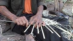 Khmu man makes fish baskets Stock Footage