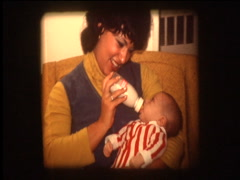 Mom feeding baby from bottle Stock Footage