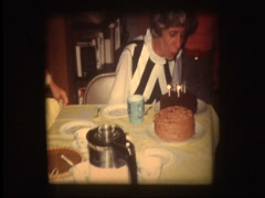 Gag birthday candles wont blow out Stock Footage