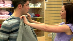 Man and woman trying on sportswear - stock footage