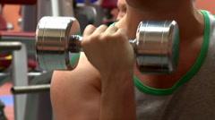 Muscular man using dumbbells Stock Footage