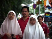 Stock Video Footage of Malaysian Women walking to Mosque, Kuala Lumpur_GFSD