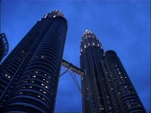 Stock Video Footage of Petronas Towers at Night with Birds flying, Kuala Lumpur GFSD